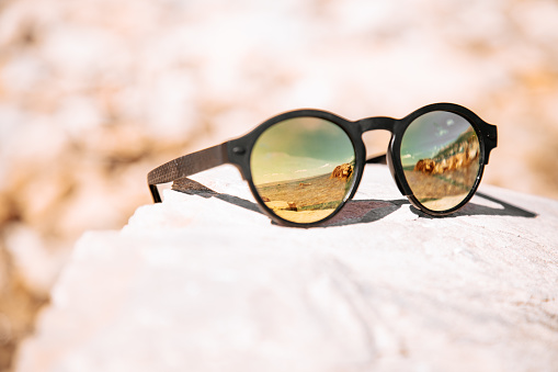 A pair of sunglasses Description automatically generated with medium confidence